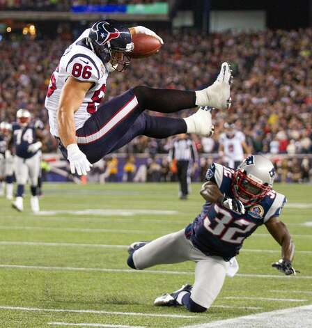 Texans fullback James Casey (86) is stopped short of the goal line by Patriots free safety Devin McCourty (32) during the third quarter. (Brett Coomer / Houston Chronicle)
