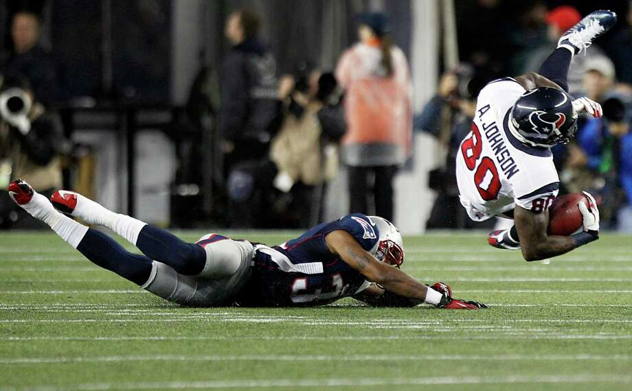 Texans receiver Andre Johnson (80) is upended by Patriots cornerback Aqib Talib (31) during the first quarter Monday night. It was a rough ride for the Texans receiver all night as he was limited to catches for yards by the Pats. Photo: Brett Coomer, Staff / © 2012  Houston Chronicle
