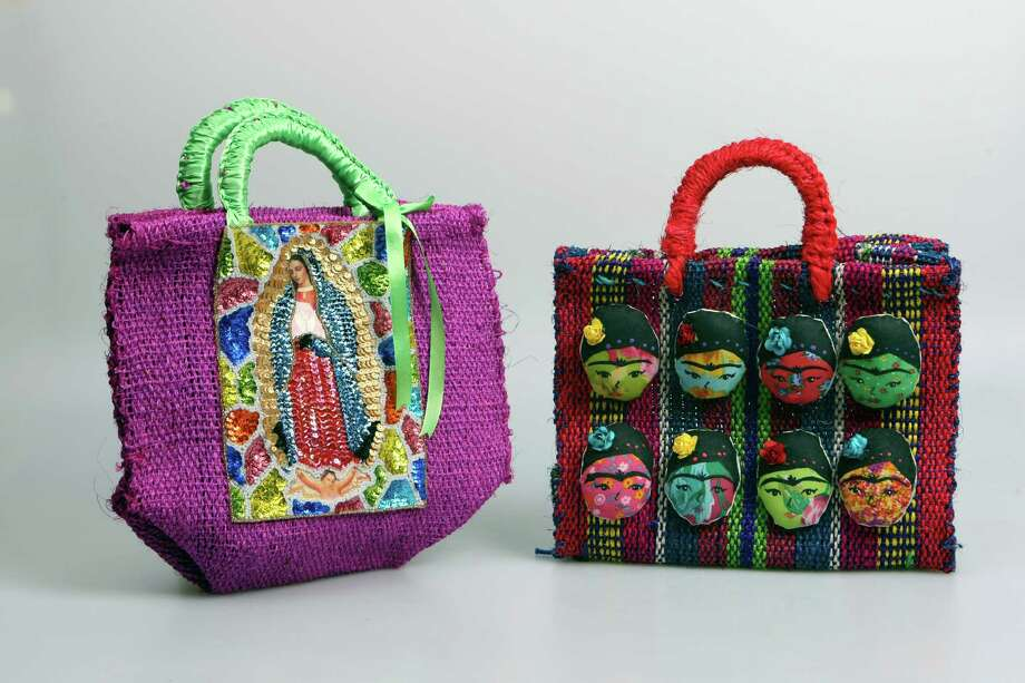 Handmade handbags  Cost: $48-$58  Where: Nativa, 5124 Broadway, 210-829-5555  Info: Straight from a village in central Mexico, these fair trade handbags depict Our Lady of Guadalupe and Frida Kahlo, but the store has many more culturally relevant designs to choose from. Photo: Helen L. Montoya, San Antonio Express-News / ©SAN ANTONIO EXPRESS-NEWS
