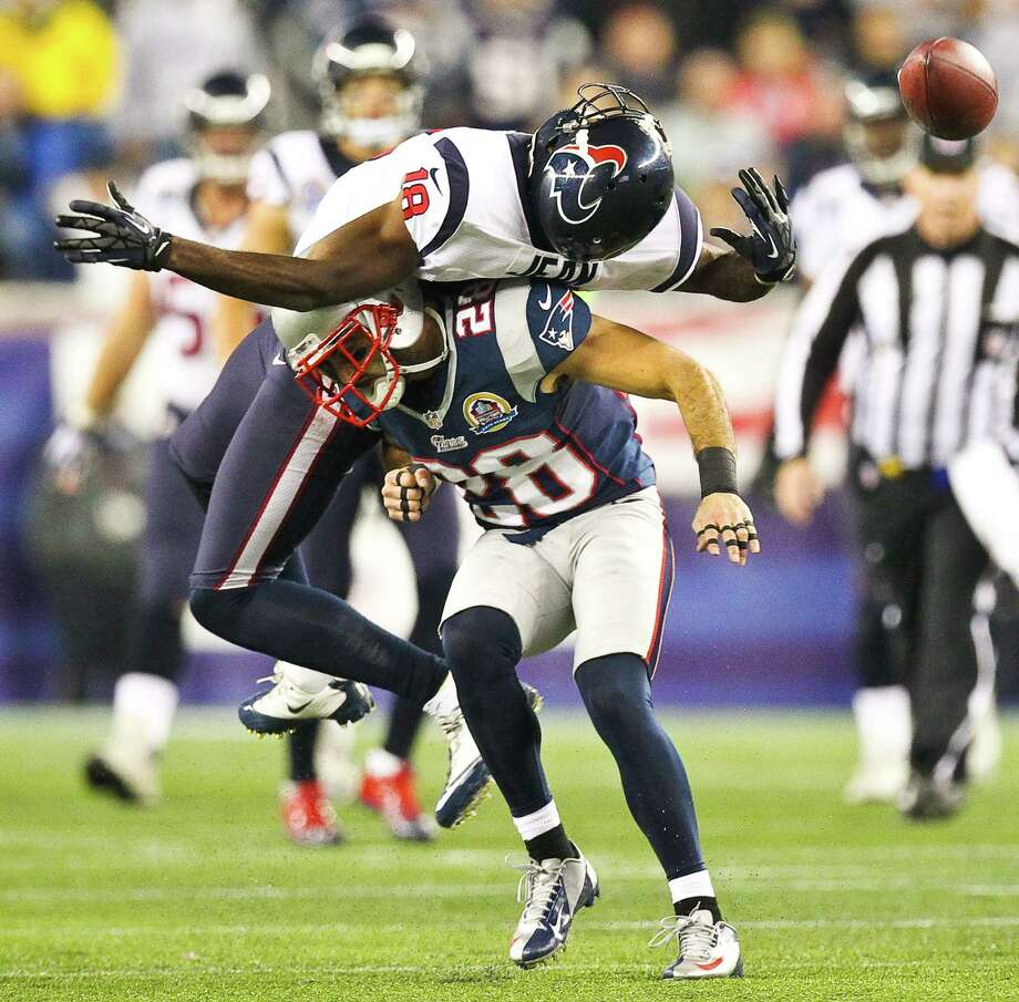 Houston Texans wide receiver Lestar Jean (18) can't catch a fourth down pass as New England Patriots strong safety Steve Gregory (28) delivers the hit. Photo: Nick De La Torre, Houston Chronicle / © 2012  Houston Chronicle
