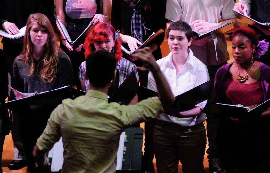 J. Brayton Bollenbacher leads the Diverse Harmony choir during a Service of Marriage at the First Baptist Church. Photo: LINDSEY WASSON / SEATTLEPI.COM