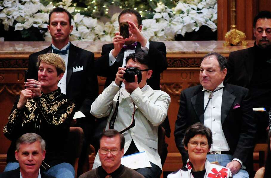 Newlyweds take a chance to photograph the audience.