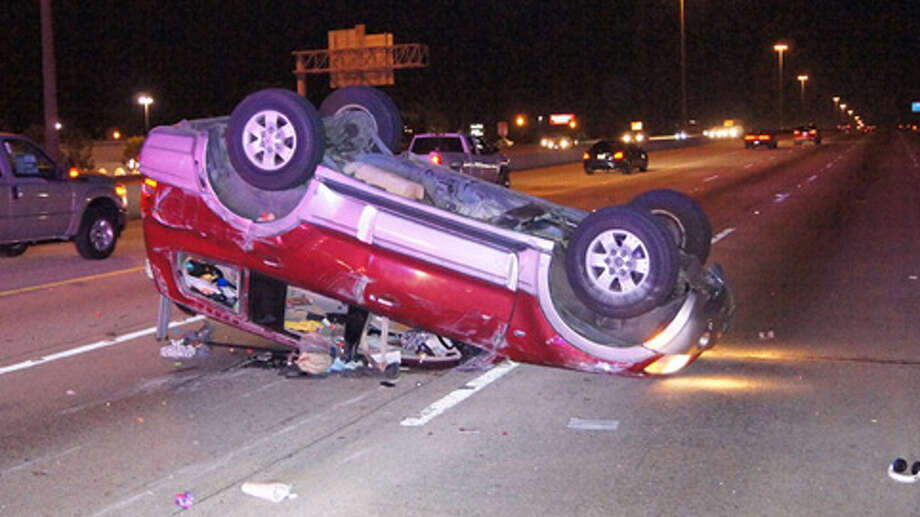 A mattress lying in the middle of southbound Interstate 45 flipped an SUV in Shenandoah, but a couple and their friend walked away with minor injuries Monday night. (Scott Engle / Montgomery County Police Reporter) Photo: Montgomery County Police Reporter