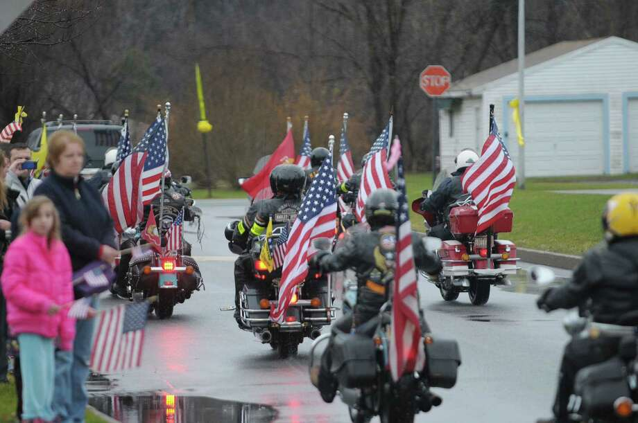 Patriot Guard riders were part of the motorcade that escorted the body of Marine Corps Lance Cpl. Anthony Denier through the high school grounds on Monday, Dec. 10, 2012 in Mechanicville, NY.  Lance Cpl. Denier was killed by enemy fire while on patrol Dec. 2. in Marjah, Afghanistan.   (Paul Buckowski / Times Union) Photo: Paul Buckowski  / 00020401A