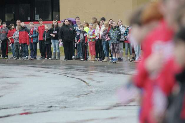 Mechanicville students stand outside the school as the motorcade with the hearse carrying the body of Marine Corps Lance Cpl. Anthony Denier drives through the school grounds on Monday, Dec. 10, 2012 in Mechanicville, NY.  Lance Cpl. Denier was killed by enemy fire while on patrol Dec. 2. in Marjah, Afghanistan.   (Paul Buckowski / Times Union) Photo: Paul Buckowski / 00020401A