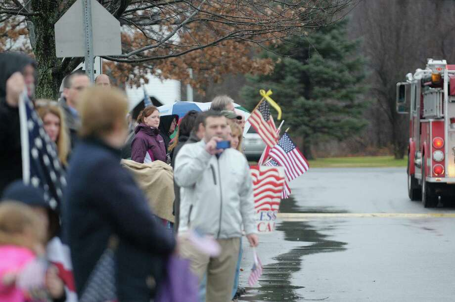 People line the street as the motorcade with the hearse carrying the body of Marine Corps Lance Cpl. Anthony Denier passes by on  Monday, Dec. 10, 2012 in Mechanicville, NY.  Lance Cpl. Denier was killed by enemy fire while on patrol Dec. 2. in Marjah, Afghanistan.   (Paul Buckowski / Times Union) Photo: Paul Buckowski  / 00020401A