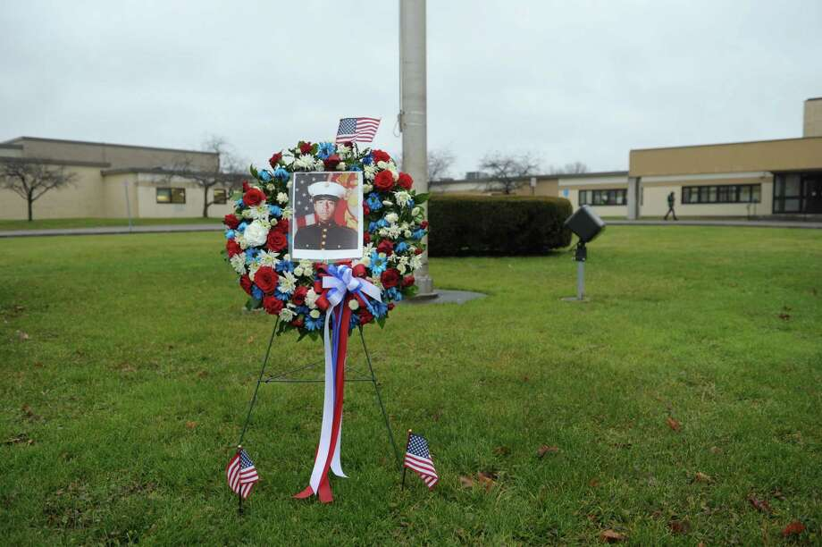 A wreath with a photograph of Marine Corps Lance Cpl. Anthony Denier is seen outside of Mechanicville High School on Monday, Dec. 10, 2012 in Mechanicville, NY.  Lance Cpl. Denier was killed by enemy fire while on patrol Dec. 2. in Marjah, Afghanistan.   (Paul Buckowski / Times Union) Photo: Paul Buckowski  / 00020401A
