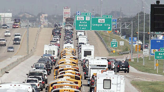 "Galveston Independent School District buses used to evacuate Galveston residents from Hurricane Rita leave Galveston County 21 September, 2005, along Interstate 45, just north of League City, Texas. US President George W. Bush on Wednesday urged people in the path of powerful Hurricane Rita to heed local authorities' evacuation orders. ""Mandatory evacuations have been ordered for New Orleans and Galveston. I urge the citizens to listen carefully to the instructions provided by state and local authorities. And follow them,"" Bush said.   AFP PHOTO/James NIELSEN Photo: JAMES NIELSEN, . / AFP"