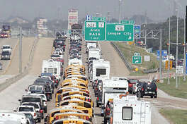 "Galveston Independent School District buses used to evacuate Galveston residents from Hurricane Rita leave Galveston County 21 September, 2005, along Interstate 45, just north of League City, Texas. US President George W. Bush on Wednesday urged people in the path of powerful Hurricane Rita to heed local authorities' evacuation orders. ""Mandatory evacuations have been ordered for New Orleans and Galveston. I urge the citizens to listen carefully to the instructions provided by state and local authorities. And follow them,"" Bush said.   AFP PHOTO/James NIELSEN"