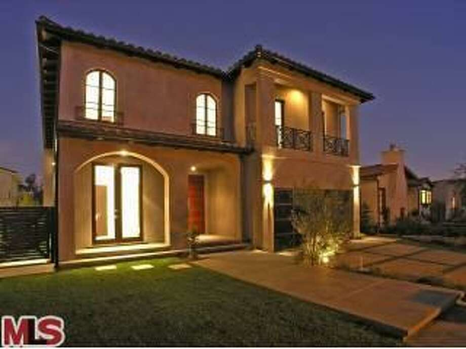 Pacman Pacquiao's home lit up as night falls. (Redfin)