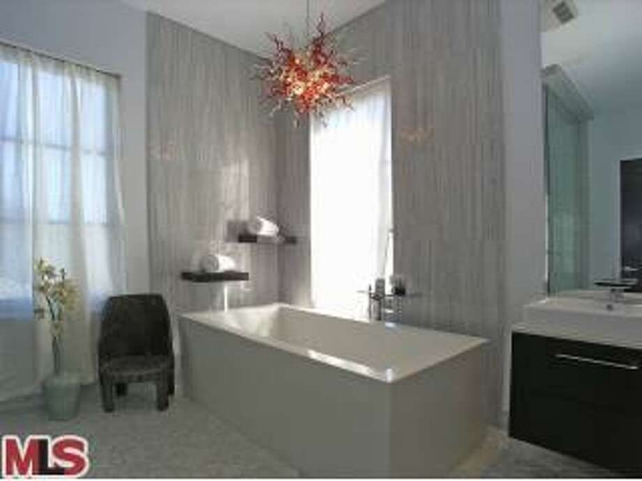 The Pacquiaos kept the red glass light fixture (or sculpture?) hanging over the tub in the master bathroom. (Redfin)