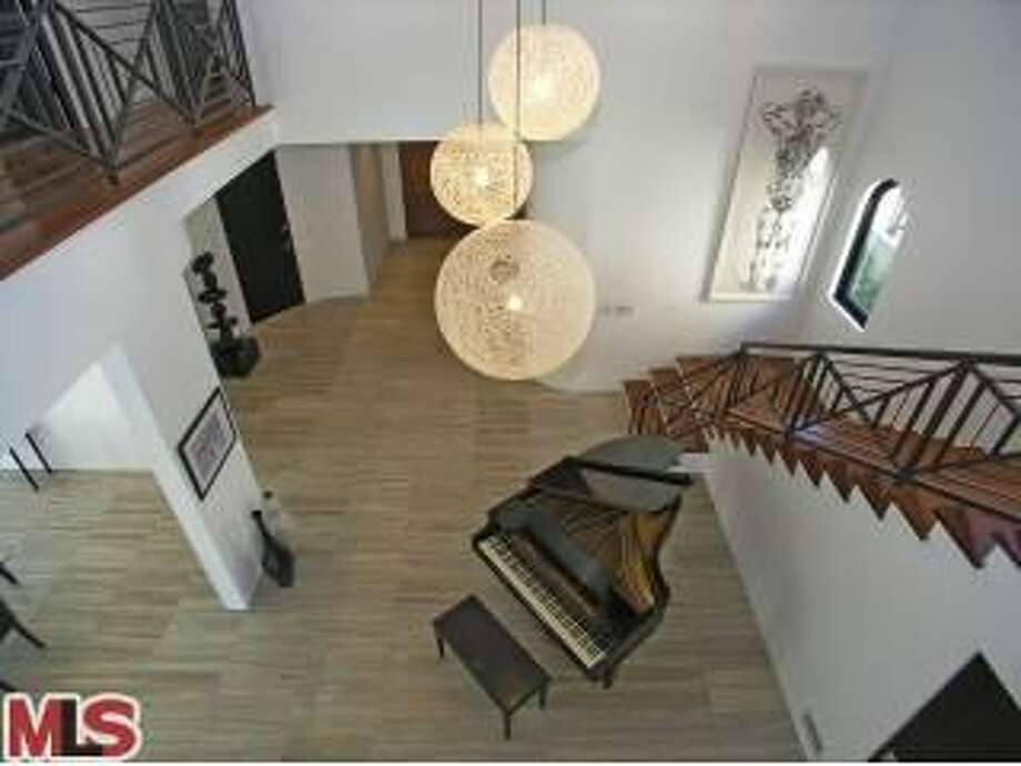 The foyer viewed from upstairs. (Redfin)