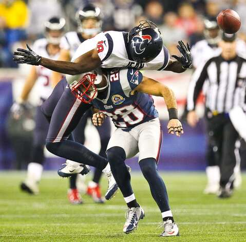 Texans wide receiver Lestar Jean (18) can't catch a fourth down pass as Patriots strong safety Steve Gregory (28) delivers the hit during the second quarter at Gillette Stadium in Foxborough. (Nick de la Torre / Houston Chronicle)