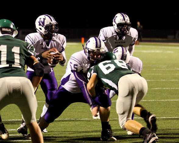 Newton's Dale Dean drops back to pass. Photo: Sherry Tracy