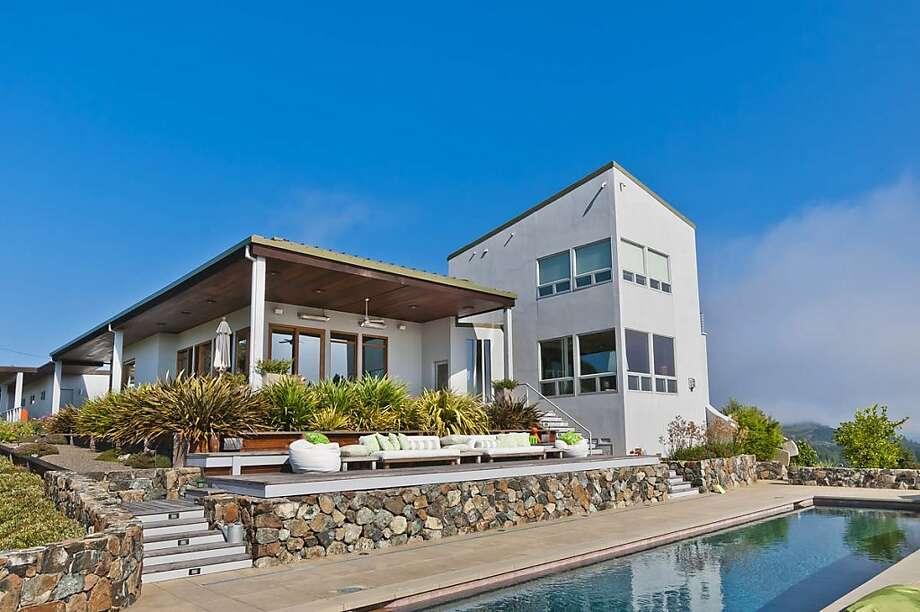 The home features a 50-foot, solar-heated swimming pool. Photo: Olga Soboleva/Vanguard Propertie