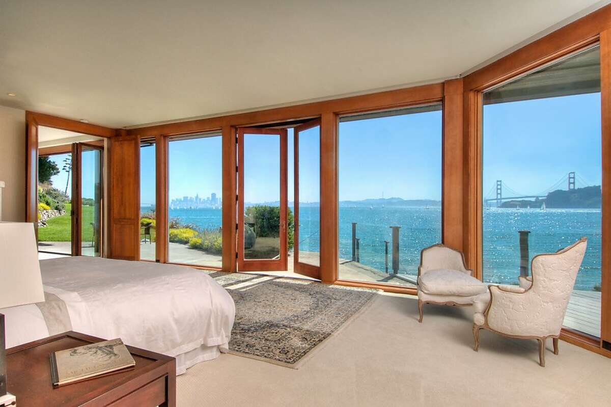 The home features a launching spot for kayaks, visible from one of the bedrooms.