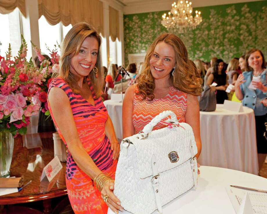 Dee Dee Guggenheim and Megan Sutton-Reed, from left at Heroes and Handbags, a March 29 event that benefitted the families of children with cancer. The event was held at the River Oaks Country Club.  Photo: Craig Hartley, For The Chronicle / Copyright: Craig H. Hartley