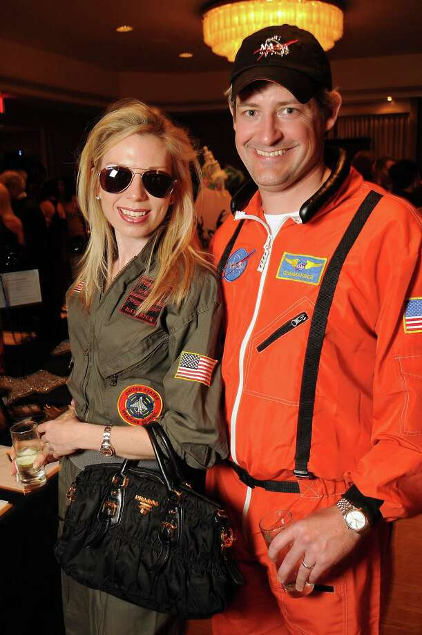 Leah and Benjamin Thomas dressed as NASA pilots at the Masquerade Ball, benefitting Stages Repertory Theater at the Four Seasons on March 24. Photo: Dave Rossman, For The Chronicle / © 2012 Dave Rossman
