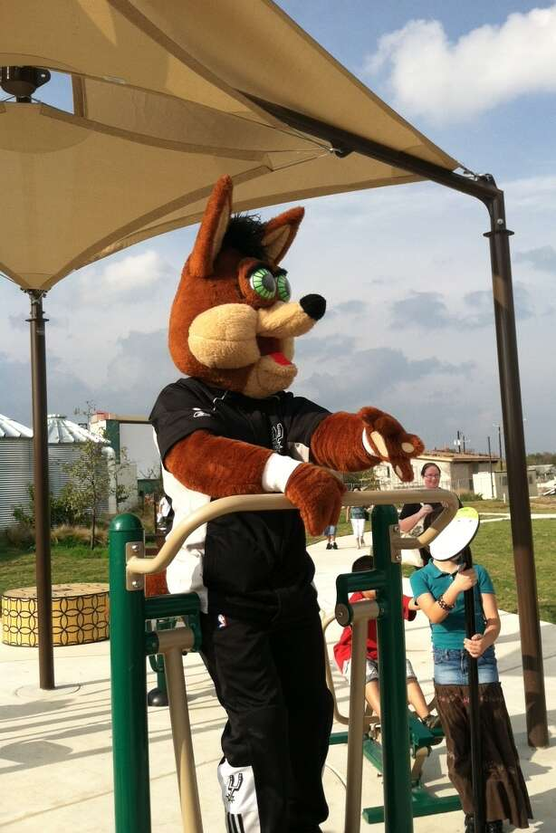 The Spurs Coyote and some kids check out the new fitness equipment at the Mission branch library in San Antonio. Courtesy photo Photo: Courtesy Photo