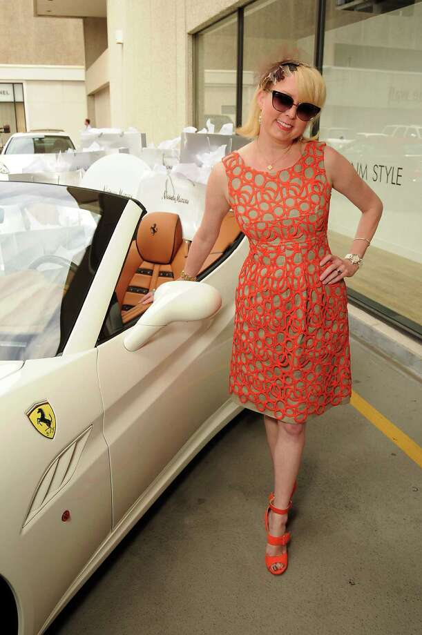 Vivian Wise with the new Ferrari California at the Ferrari event at Neiman Marcus Monday June 18. Photo: Dave Rossman, For The Chronicle / 2012 Dave Rossman