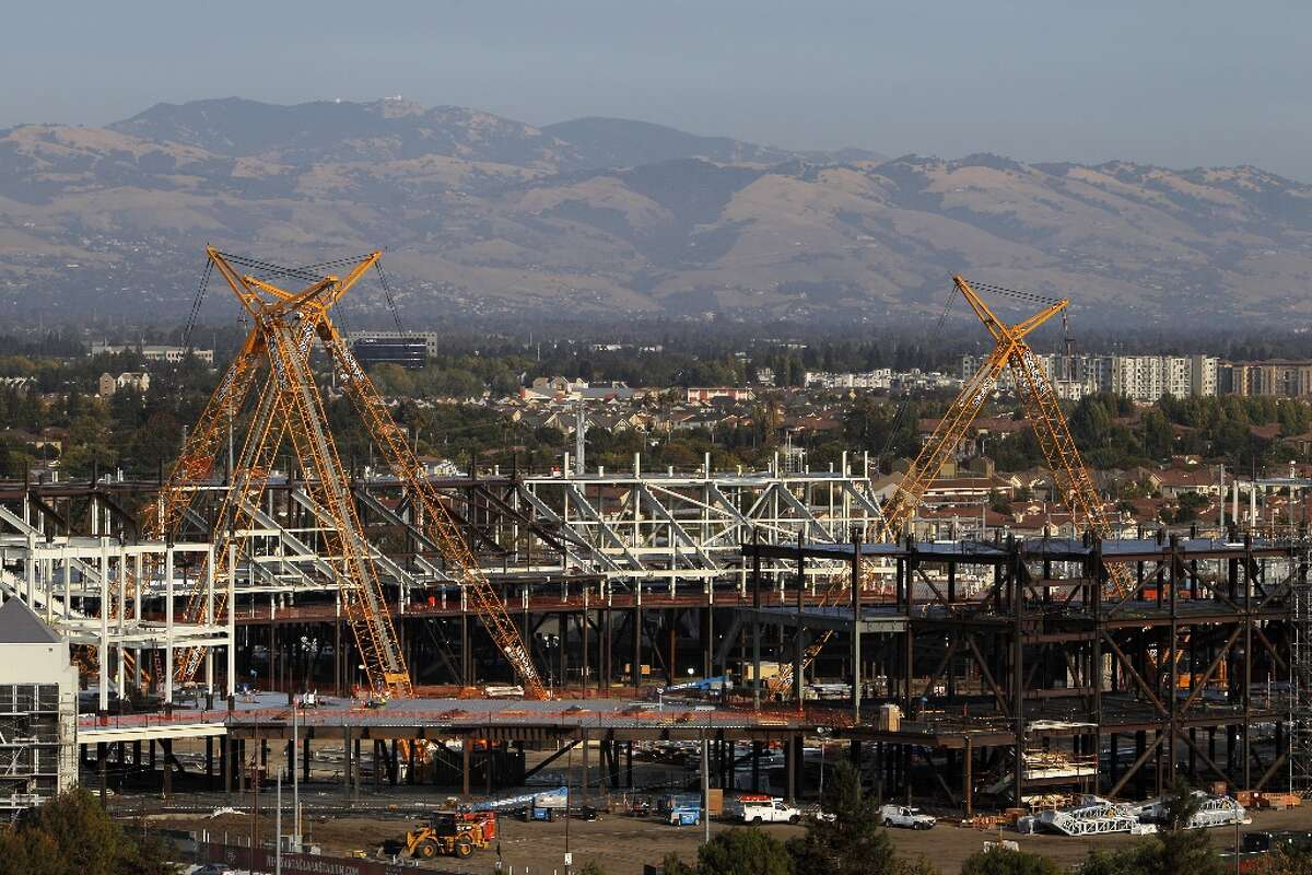 Construction workers are seen on the lattice work of structural steel that will be the new 49ers' stadium as work underway on Tuesday, September 25, 2012, in Santa Clara, Calif. The stadium is scheduled to open in 2014, and the 49ers will make the stadium their new home.