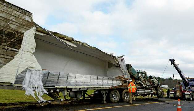 A tractor trailer carrying yogurt is righted after rolling over on the Berkshire Spur of the New York State Thruway between exit B-1 and B-2 in the eastbound lane in North Chatham, N.Y. Dec 11, 2012.  (Skip Dickstein/Times Union) Photo: SKIP DICKSTEIN