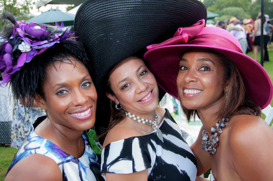 Vernicka Sales, Tracie Payne and Nomathemba Armstrong show off their hats at the Texas Spring Cypress chapter of The Links annual gala at the Houston Polo Club on  Oct. 14. The gala raised money for scholarships for six high school seniors in the Acres Homes area. Photo: Grady Carter