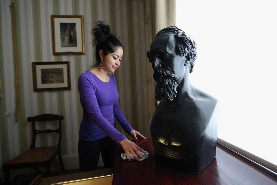LONDON, ENGLAND - DECEMBER 07:  A woman cleans a table next to Dickens' death mask in a bedroom inside the Charles Dickens Museum on December 7, 2012 in London, England. The museum will re-open to the public on December 10, 2012 following a major 3.1 million GBP refurbishment and expansion programme to celebrate Dickens' bicentenary year. The museum is located in Charles Dickens' house on Doughty Street where he lived from 1837 until 1839 and in which he wrote many novels including Oliver Twist and Nicholas Nickleby. Photo: Oli Scarff, Getty Images / 2012 Getty Images