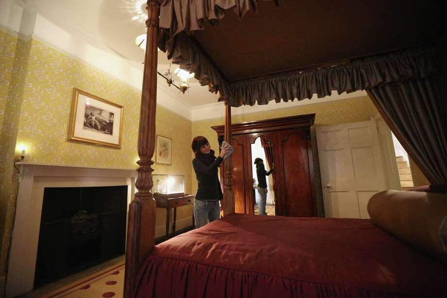 LONDON, ENGLAND - DECEMBER 07:  A woman cleans Charles Dickens' bedroom inside the Charles Dickens Museum on December 7, 2012 in London, England. The museum will re-open to the public on December 10, 2012 following a major 3.1 million GBP refurbishment and expansion programme to celebrate Dickens' bicentenary year. The museum is located in Charles Dickens' house on Doughty Street where he lived from 1837 until 1839 and in which he wrote many novels including Oliver Twist and Nicholas Nickleby. Photo: Oli Scarff, Getty Images / 2012 Getty Images