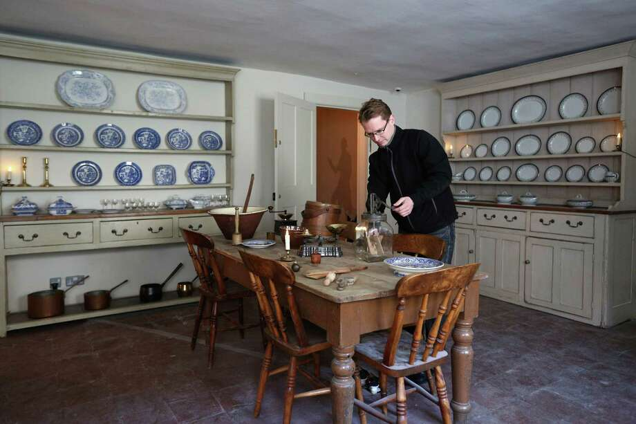 LONDON, ENGLAND - DECEMBER 07:  A man operates a butter churn in the kitchen inside the Charles Dickens Museum on December 7, 2012 in London, England. The museum will re-open to the public on December 10, 2012 following a major 3.1 million GBP refurbishment and expansion programme to celebrate Dickens' bicentenary year. The museum is located in Charles Dickens' house on Doughty Street where he lived from 1837 until 1839 and in which he wrote many novels including Oliver Twist and Nicholas Nickleby. Photo: Oli Scarff, Getty Images / 2012 Getty Images