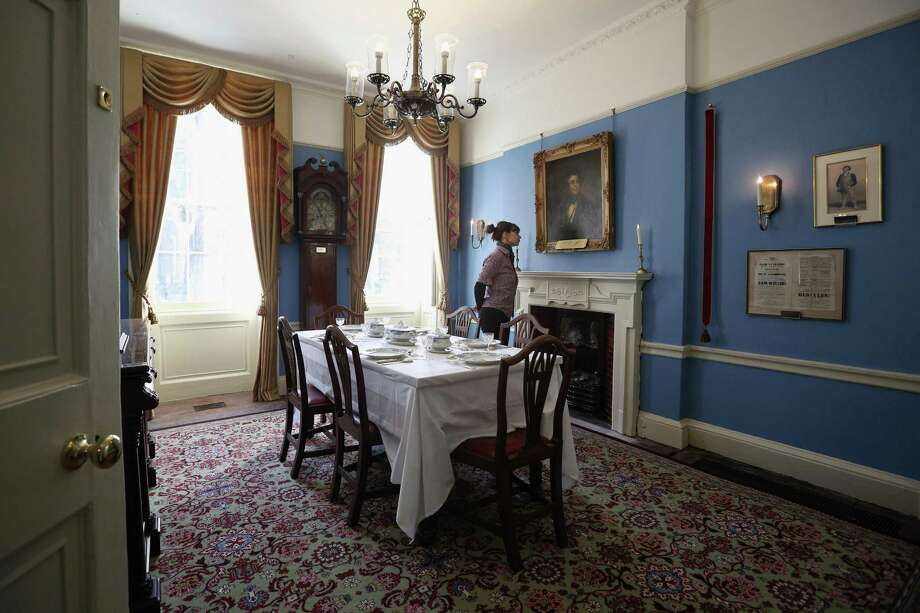 LONDON, ENGLAND - DECEMBER 07:  A woman admires the Dining Room inside the Charles Dickens Museum on December 7, 2012 in London, England. The museum will re-open to the public on December 10, 2012 following a major 3.1 million GBP refurbishment and expansion programme to celebrate Dickens' bicentenary year. The museum is located in Charles Dickens' house on Doughty Street where he lived from 1837 until 1839 and in which he wrote many novels including Oliver Twist and Nicholas Nickleby. Photo: Oli Scarff, Getty Images / 2012 Getty Images