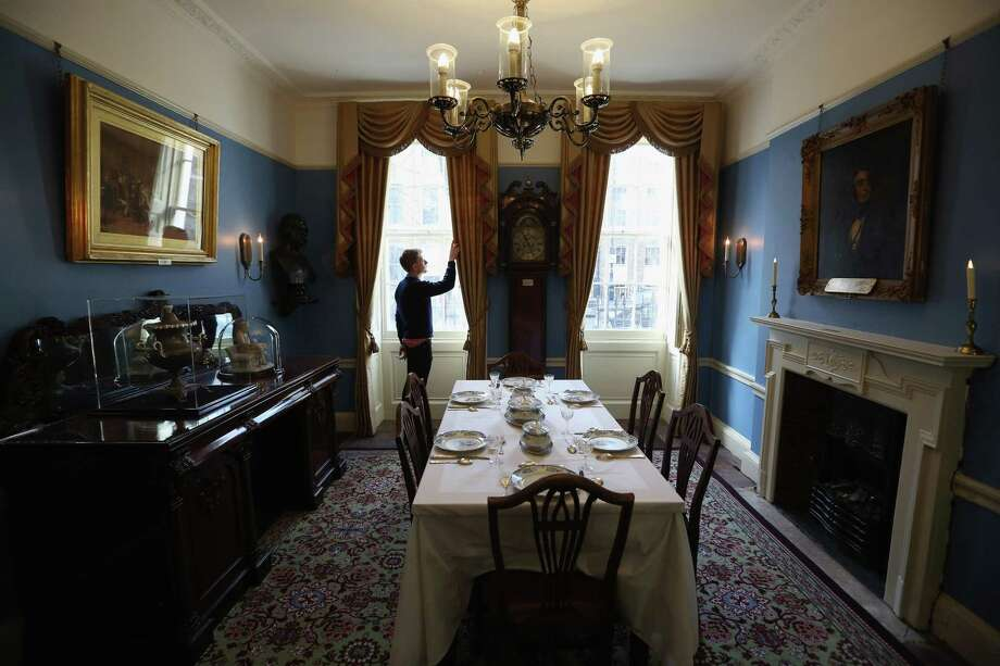 LONDON, ENGLAND - DECEMBER 07:  A man adjusts the decor in the Dining Room inside the Charles Dickens Museum on December 7, 2012 in London, England. The museum will re-open to the public on December 10, 2012 following a major 3.1 million GBP refurbishment and expansion programme to celebrate Dickens' bicentenary year. The museum is located in Charles Dickens' house on Doughty Street where he lived from 1837 until 1839 and in which he wrote many novels including Oliver Twist and Nicholas Nickleby. Photo: Oli Scarff, Getty Images / 2012 Getty Images