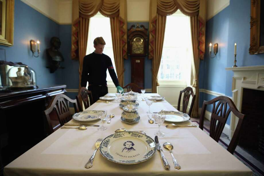 LONDON, ENGLAND - DECEMBER 07:  A man adjusts the cutlery in the Dining Room inside the Charles Dickens Museum on December 7, 2012 in London, England. The museum will re-open to the public on December 10, 2012 following a major 3.1 million GBP refurbishment and expansion programme to celebrate Dickens' bicentenary year. The museum is located in Charles Dickens' house on Doughty Street where he lived from 1837 until 1839 and in which he wrote many novels including Oliver Twist and Nicholas Nickleby. Photo: Oli Scarff, Getty Images / 2012 Getty Images
