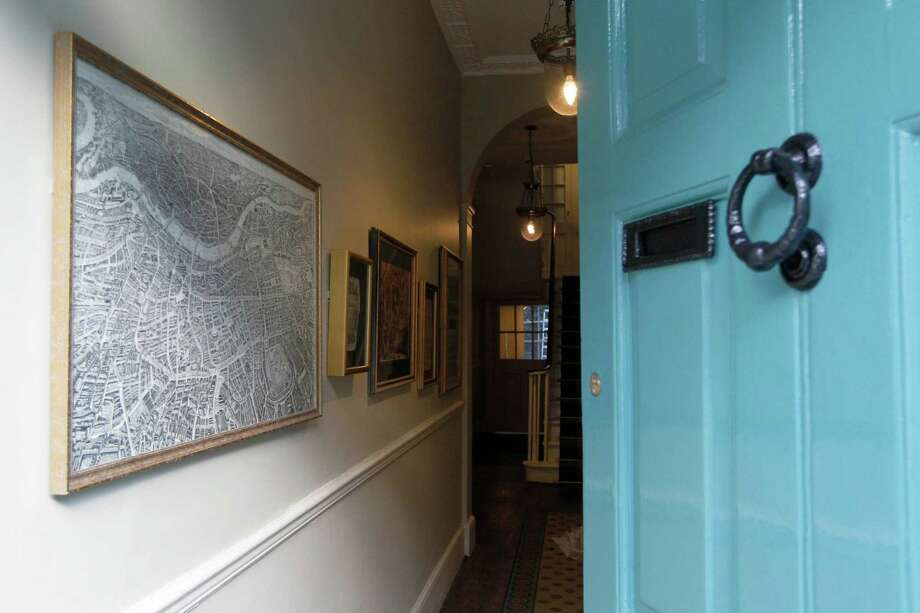 "The entrance hallway is seen in Charles Dickens' home, part of the Charles Dickens Museum in London, Wednesday, Dec. 5, 2012. For years, the four-story brick row house where the author lived with his young family was a dusty and slightly neglected museum, a mecca for Dickens scholars but overlooked by most visitors to London. Now, after a 3 million pound ($4.8 million) makeover, it has been restored to bring the writer's world to life. Its director says it aims to look ""as if Dickens had just stepped out."" (AP Photo/Sang Tan) Photo: Sang Tan, Associated Press / AP"