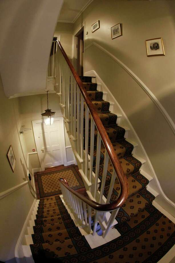 "The staircase in Charles Dickens' home, part of the Charles Dickens Museum in London, Wednesday, Dec. 5, 2012. For years, the four-story brick row house where the author lived with his young family was a dusty and slightly neglected museum, a mecca for Dickens scholars but overlooked by most visitors to London. Now, after a 3 million pound ($4.8 million) makeover, it has been restored to bring the writer's world to life. Its director says it aims to look ""as if Dickens had just stepped out."" (AP Photo/Sang Tan) Photo: Sang Tan, Associated Press / AP"