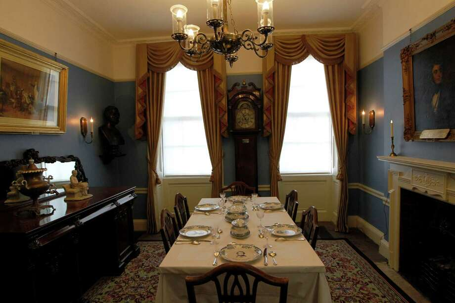 "The dining room of Charles Dickens' home, part of the Charles Dickens Museum in London, Wednesday, Dec. 5, 2012. For years, the four-story brick row house where the author lived with his young family was a dusty and slightly neglected museum, a mecca for Dickens scholars but overlooked by most visitors to London. Now, after a 3 million pound ($4.8 million) makeover, it has been restored to bring the writer's world to life. Its director says it aims to look ""as if Dickens had just stepped out."" (AP Photo/Sang Tan) Photo: Sang Tan, Associated Press / AP"