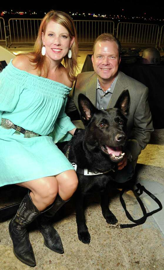 Kevin and Cheryl Ormston pose with a police dog at the HPD True Blue Gala on  Oct. 20. The event, held at the Landry's Flight Hangar at Hobby Airport, benefits the Houston Police Foundation.  Photo: Dave Rossman, For The Houston Chronicle / © 2012 Dave Rossman