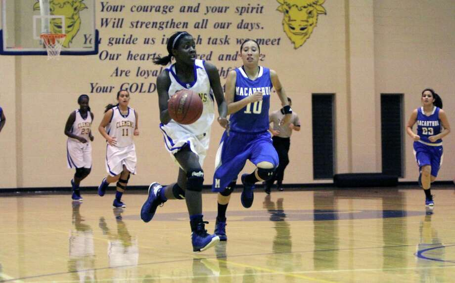 Talisha Presley (with ball), who averages 15.3 points, leads surging Clemens, which is off to a 20-4 start after finishing 13-22 last season. Photo: Greg Bell / For The NE Herald