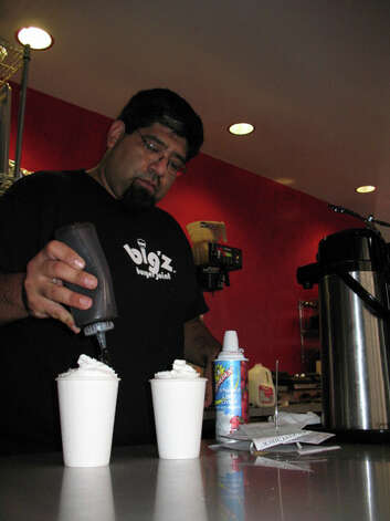 Juan Lopez fixes two hot chocolates at Sip. Photo: EMILY MESSER, 210SA / 210SA