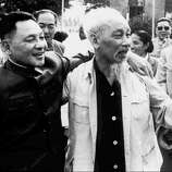 1986: Chinese leader Deng Xiaoping, left.