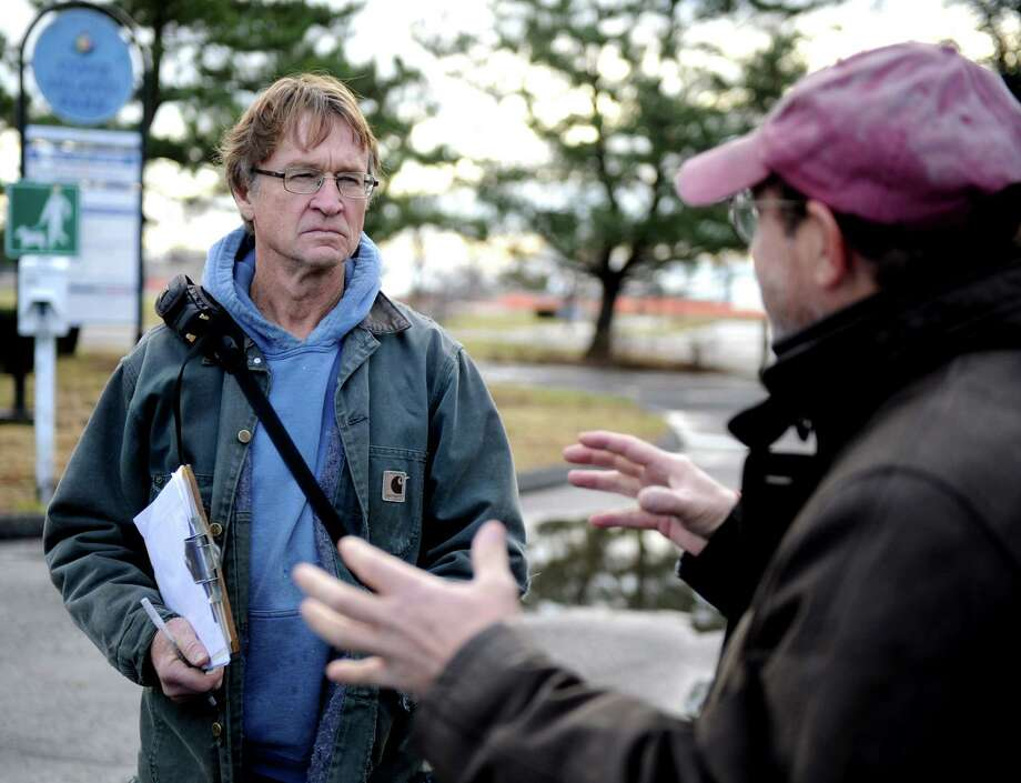 Dave Winston, Cove Island Park Conservancy President listens to Larry Weaner, owner of Larry Weaner Landscape Associates as they walk through Cove Island Park Tuesday, December 11, 2012, while discussing options for replanting and landscaping the park. Goals for the park include using plants better able to withstand harsh weather like Superstorm Sandy as well as encouraging better use of the park by people and animals. Photo: Lindsay Niegelberg / Stamford Advocate