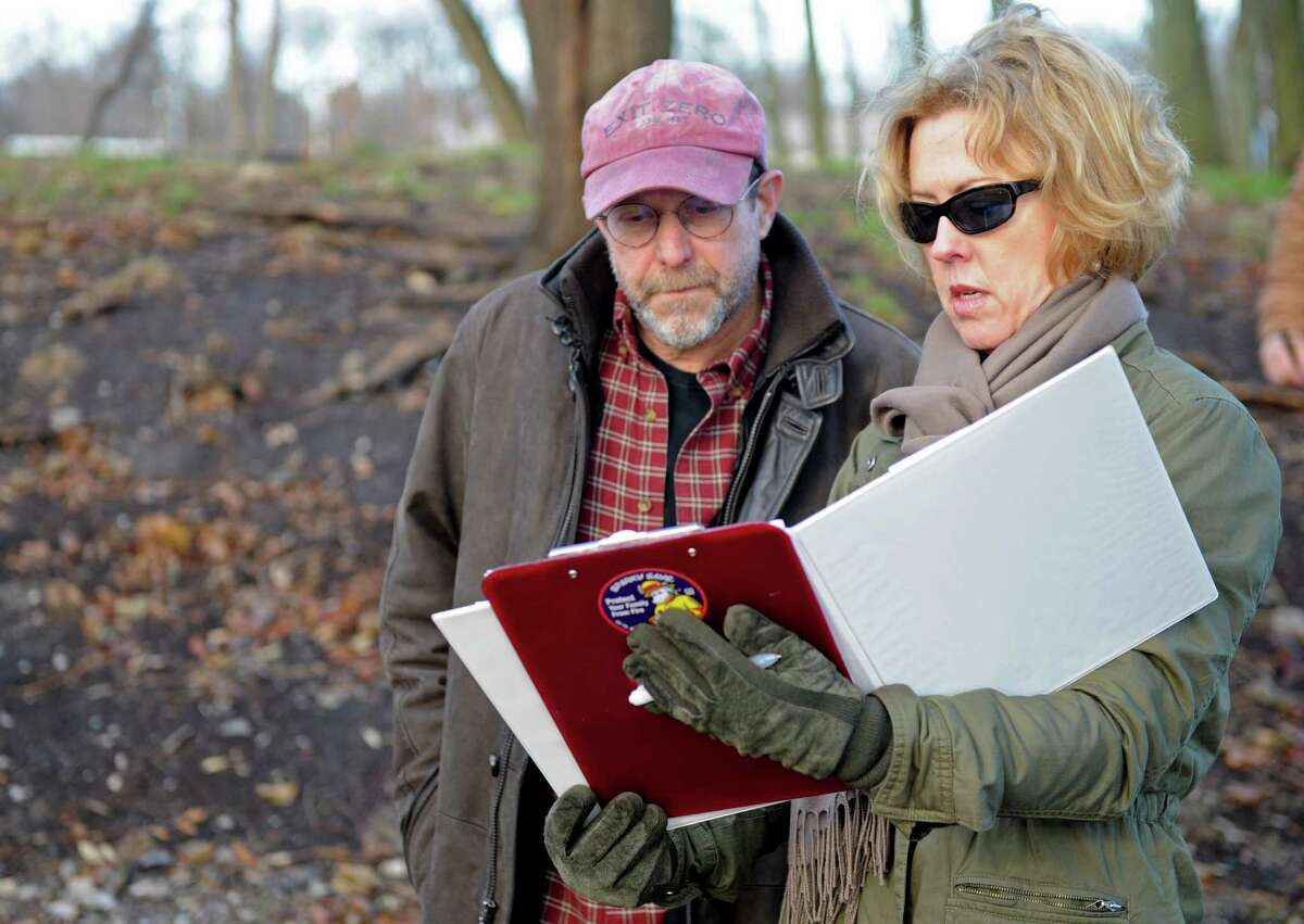 Larry Weaner, owner of Larry Weaner Landscape Associates, listens to Stamford City Senior Planner Erin McKenna as they walk through Cove Island Park Tuesday, December 11, 2012, while discussing options for replanting and landscaping the park. Goals for the park include using plants better able to withstand harsh weather like Superstorm Sandy as well as encouraging better use of the park by people and animals.