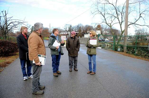 Stamford City Senior Planner Erin McKenna and a group of landscape architects walk through Cove Island Park Tuesday, December 11, 2012, while discussing options for replanting and landscaping the park. From left are; Ian Canton of Larry Weaner Landscape Associates, Wayne Lee of Larry Weaner Landscape Associates, Dave Winston, President of the Cove Island Park Conservancy, Larry Weaner, owner of Larry Weaner Landscaping Associates, and McKenna. Photo: Lindsay Niegelberg / Stamford Advocate