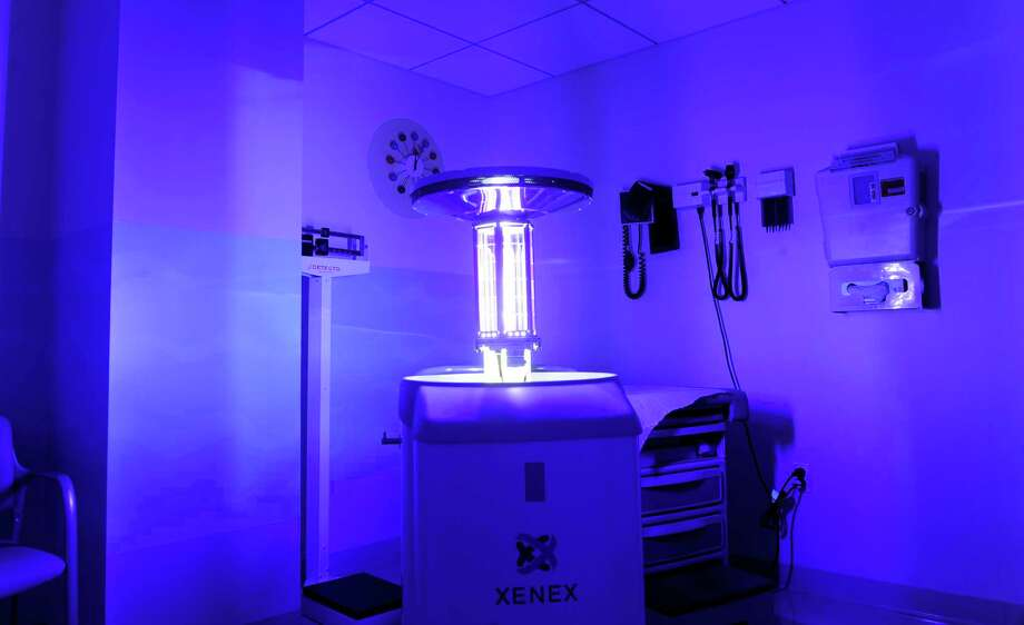 A Xenex machine bathes a room at Tully Health Center in Stamford in an ultra-violet light to sanitize the room during a demonstration of the new machine on Tuesday, December 11, 2012. Photo: Lindsay Niegelberg, Niegelberg / Stamford Advocate