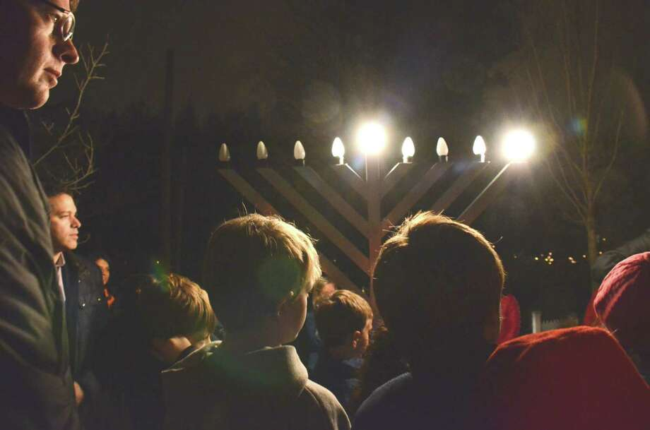 Several members of the New Canaan community and surrounding towns gathered on God's Acre in New Canaan Saturday night, December 8. 2012, on the first day of Hanukah, to participate in the lighting of the menorah. Photo: Jeanna Petersen Shepard