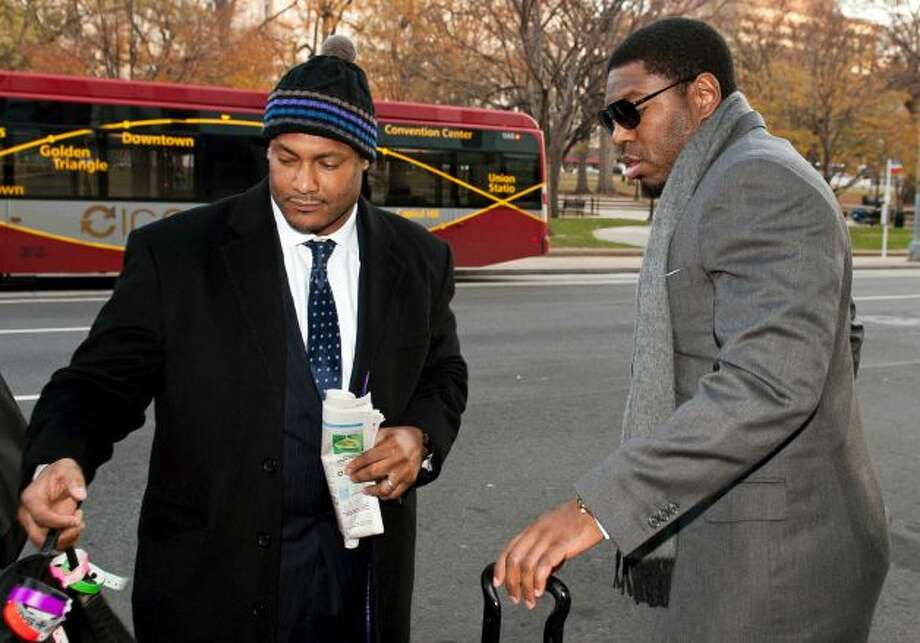FILE - In this Nov. 30, 2012, file photo, New Orleans Saints football defensive end Will Smith, left, and linebacker Jonathan Vilma arrive at an attorney's office in Washington, for a hearing on their appeals of bounties suspensions. Former Commissioner Paul Tagliabue, who was appointed to handle a second round of player appeals to the league, has informed all parties he planned to rule by Tuesday, Dec. 11, and his decision could affect whether two current Saints ? Jonathan Vilma and Will Smith ? get to play out the season. Photo: Cliff Owen / AP