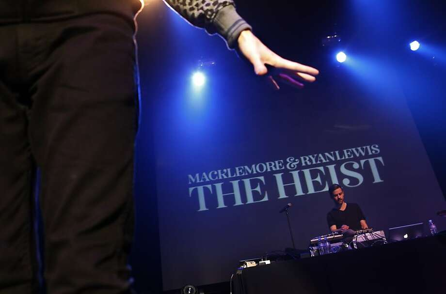 Ryan Lewis, rear, performs during The Heist World Tour Monday in San Francisco. Macklemore & Ryan Lewis performed at the Regency Theater in San Francisco, Calif., on Monday, December 10, 2012. Photo: Carlos Avila Gonzalez, The Chronicle