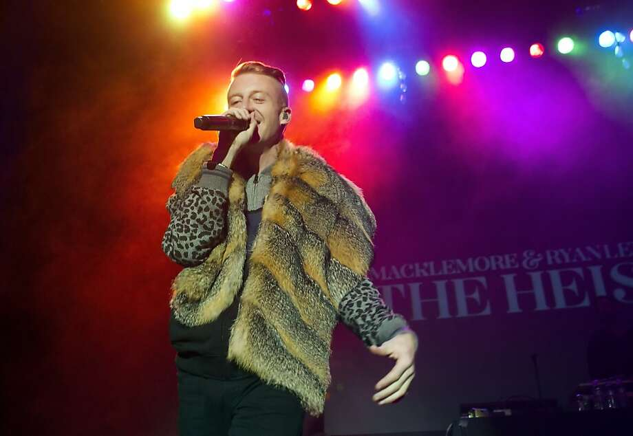 Macklemore sings during The Heist World Tour in San Francisco on Monday. Macklemore & Ryan Lewis performed at the Regency Theater in San Francisco, Calif., on Monday, December 10, 2012. Photo: Carlos Avila Gonzalez, The Chronicle