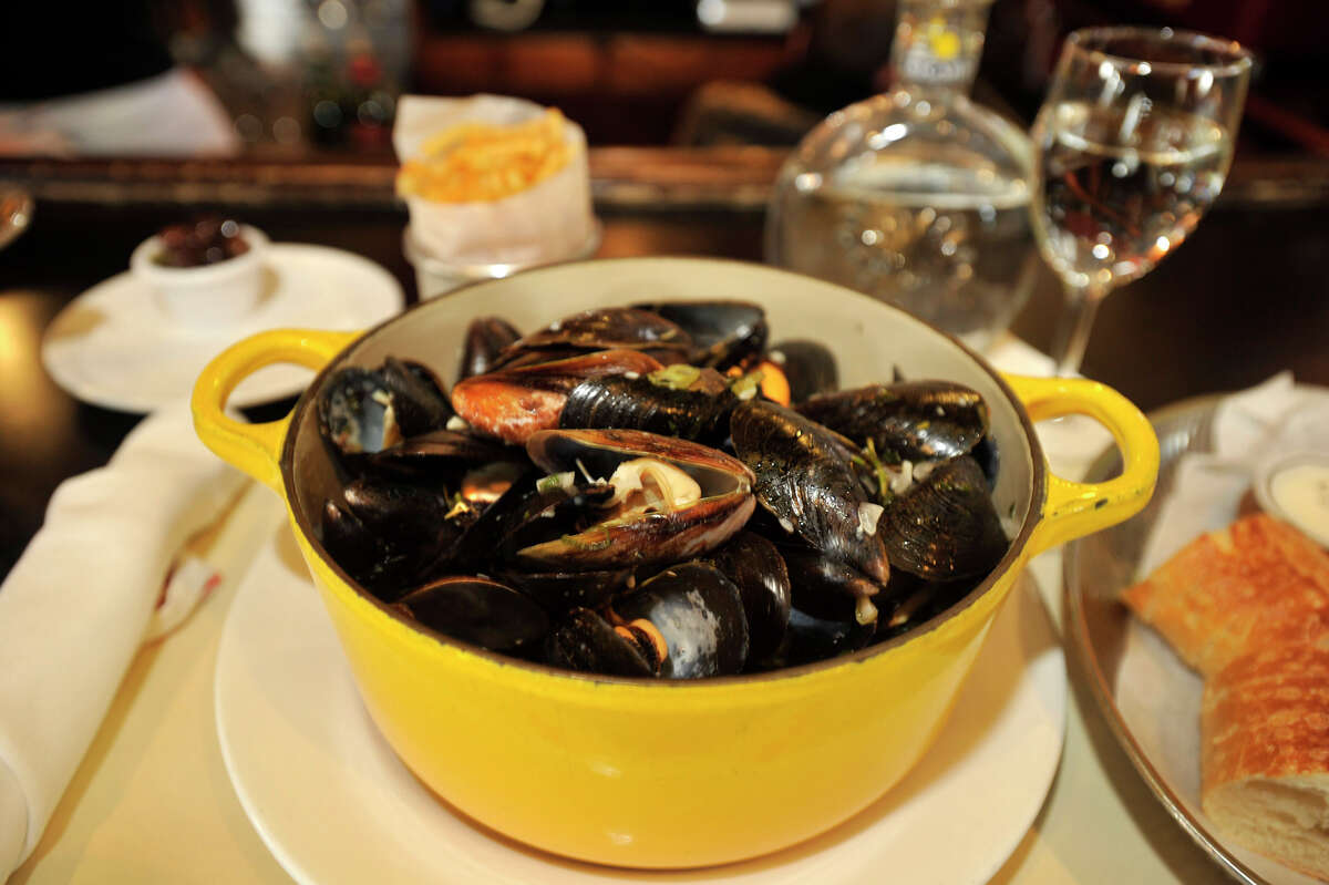 Luc's Cafe/Restaurant in Ridgefield features Le Moules Marinieres Frites, mussels steamed in a white wine broth, for dinner. Photographed on Tuesday, Dec. 11, 2012.