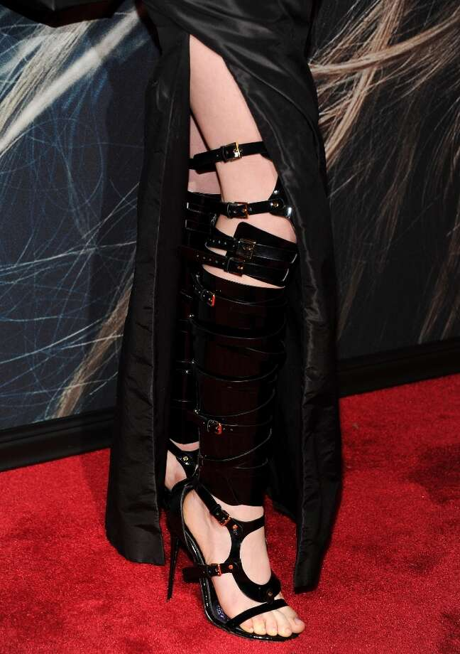 A close-up view of actress Anne Hathaway's footwear at the premiere for Les Miserables at the Ziegfeld Theatre on Monday Dec. 10, 2012 in New York. (Photo by Evan Agostini/Invision/AP) Photo: Evan Agostini, Associated Press / Invision